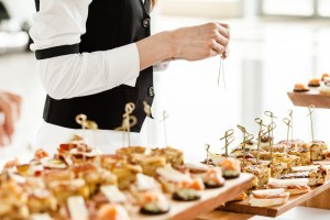 Caterer arranging hors d'oeuvres