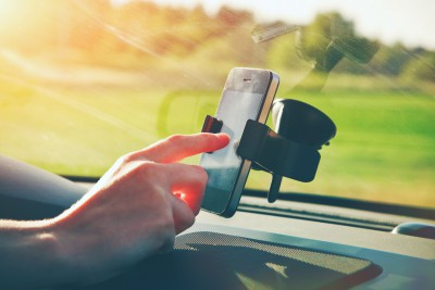 Smartphone with GPS and Tracking on Vehicle Dashboard